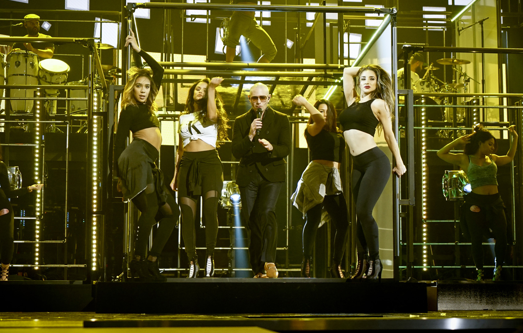 Pitbull brings some heat to the stage during his GRAMMY rehearsal.
