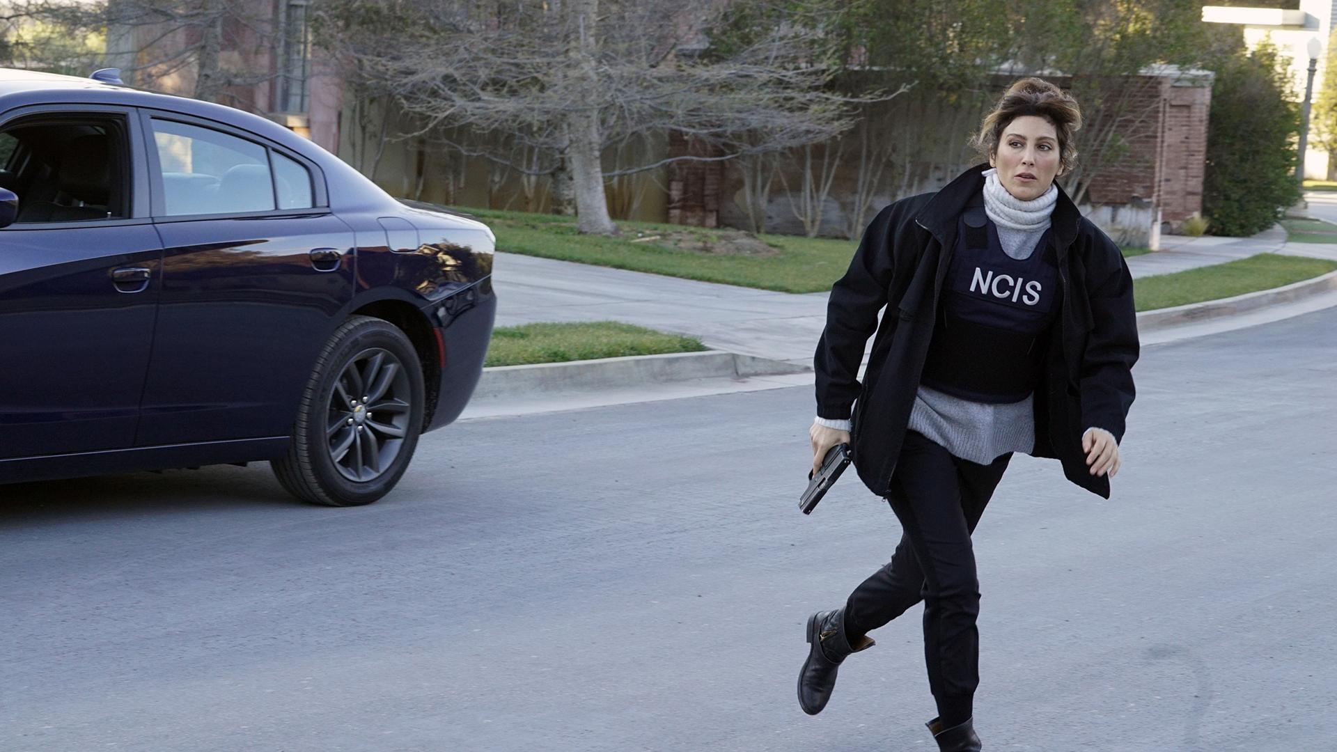Quinn bolts across the street.