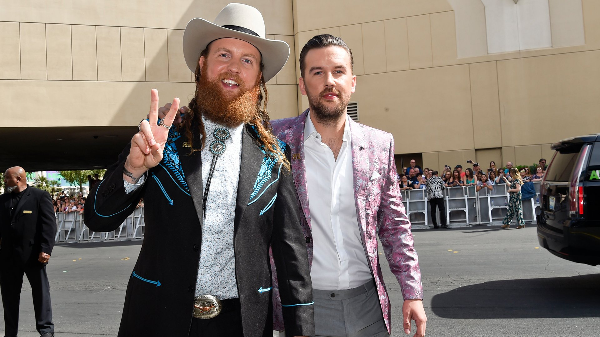 Brothers Osborne bring nothing but peace, love, and bolo ties to the ACM red carpet.