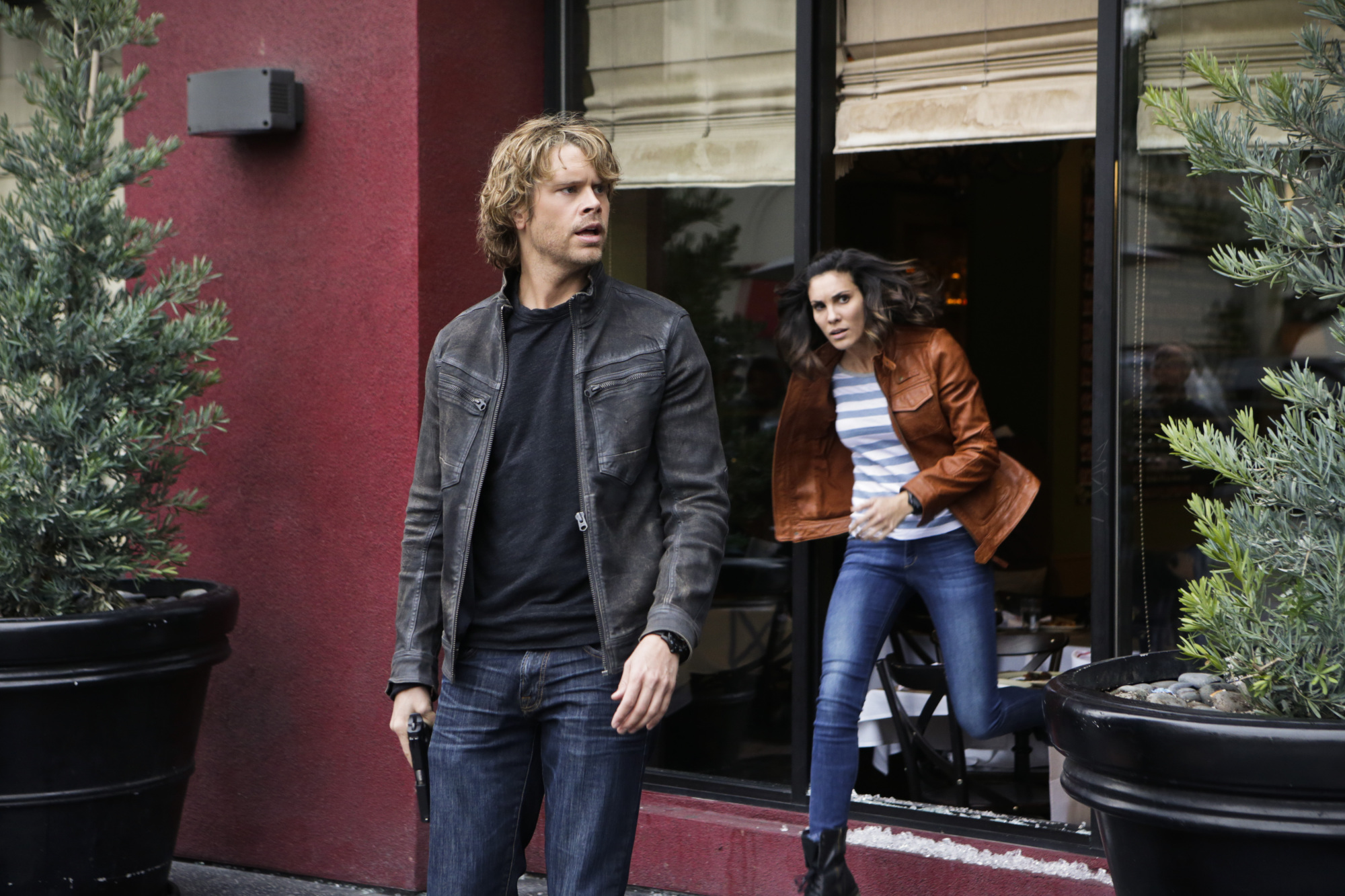 Eric Christian Olsen as LAPD Liaison Marty Deeks and Daniela Ruah as Special Agent Kensi Blye