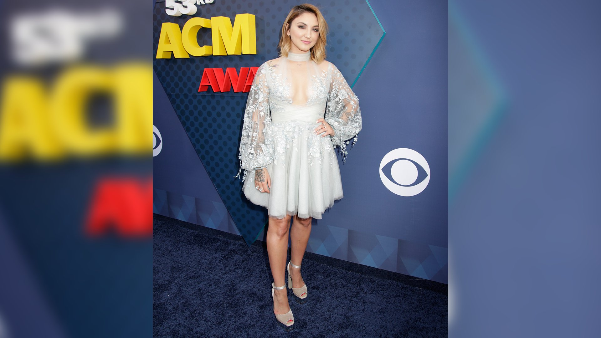 Pop singer Julia Michaels floats down the ACM red carpet before performing