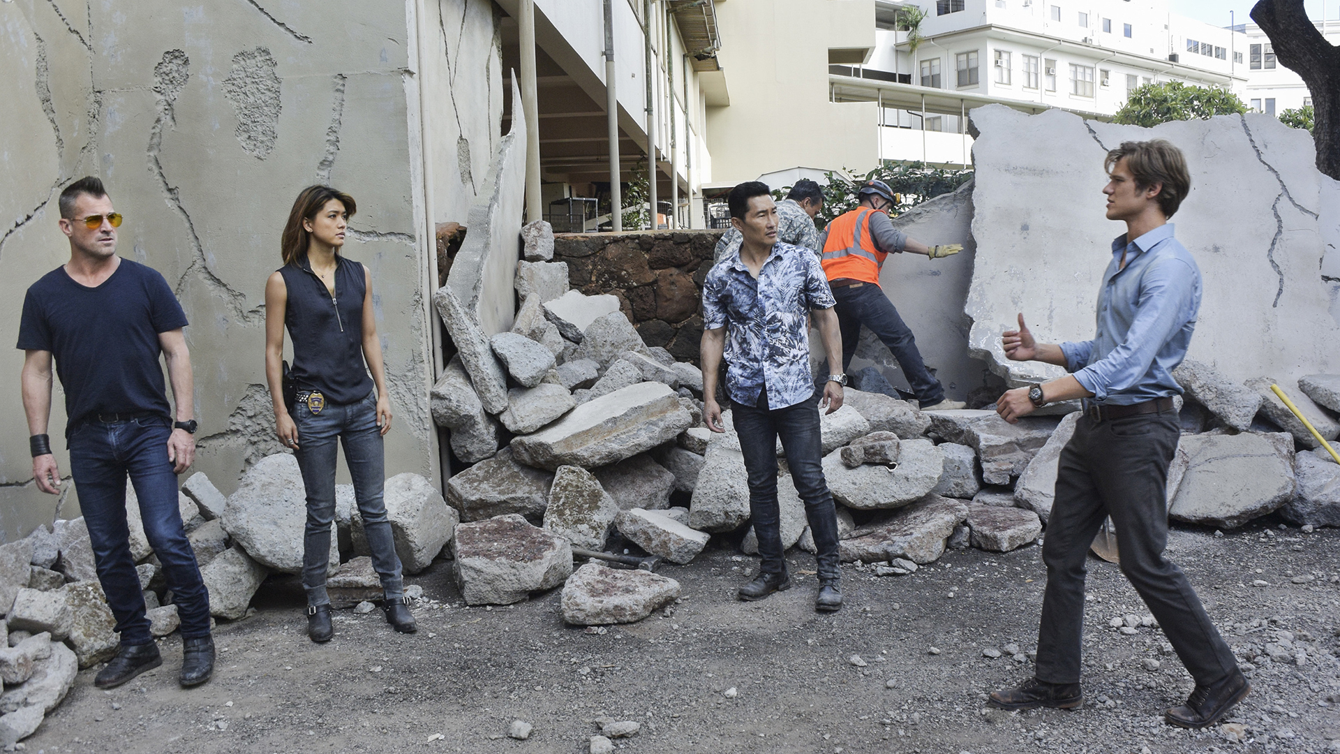 The team goes over the potential options amidst the earthquake wreckage.