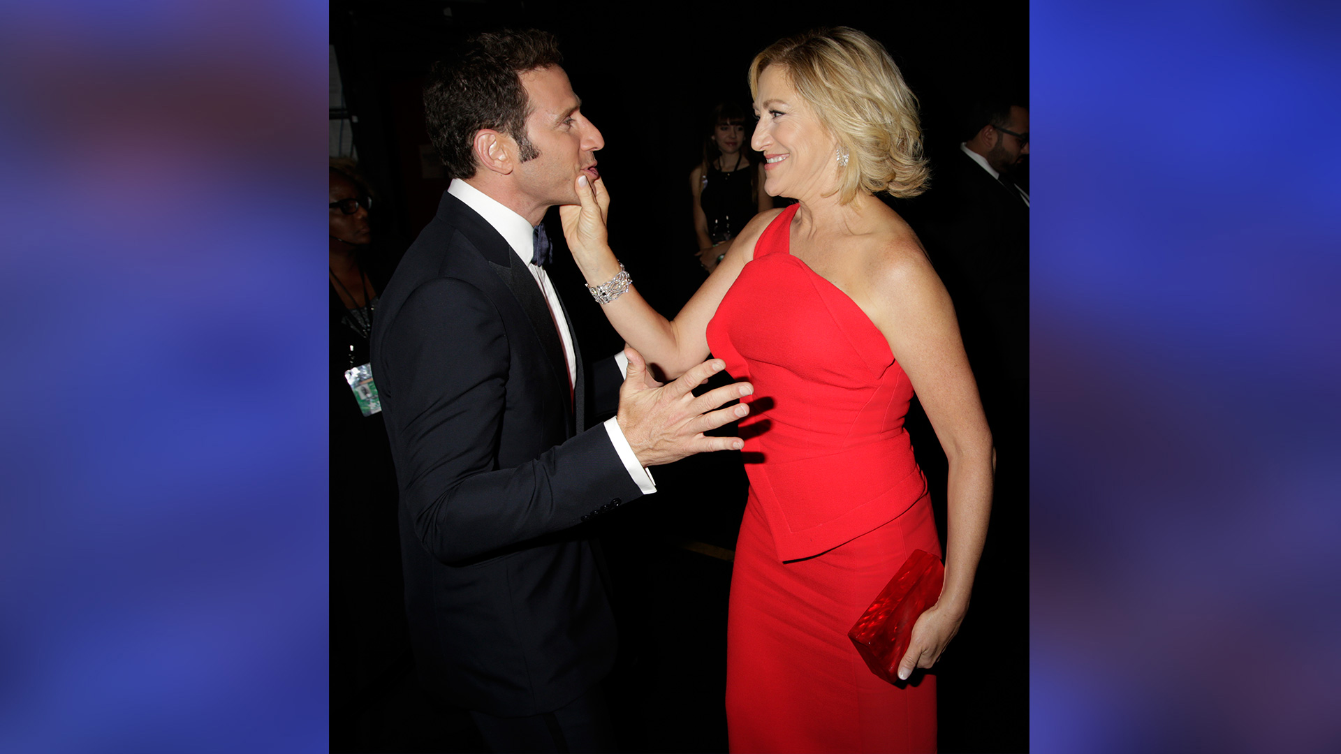 Edie Falco sweetly grabs Mark Feuerstein's face backstage at the Emmys.