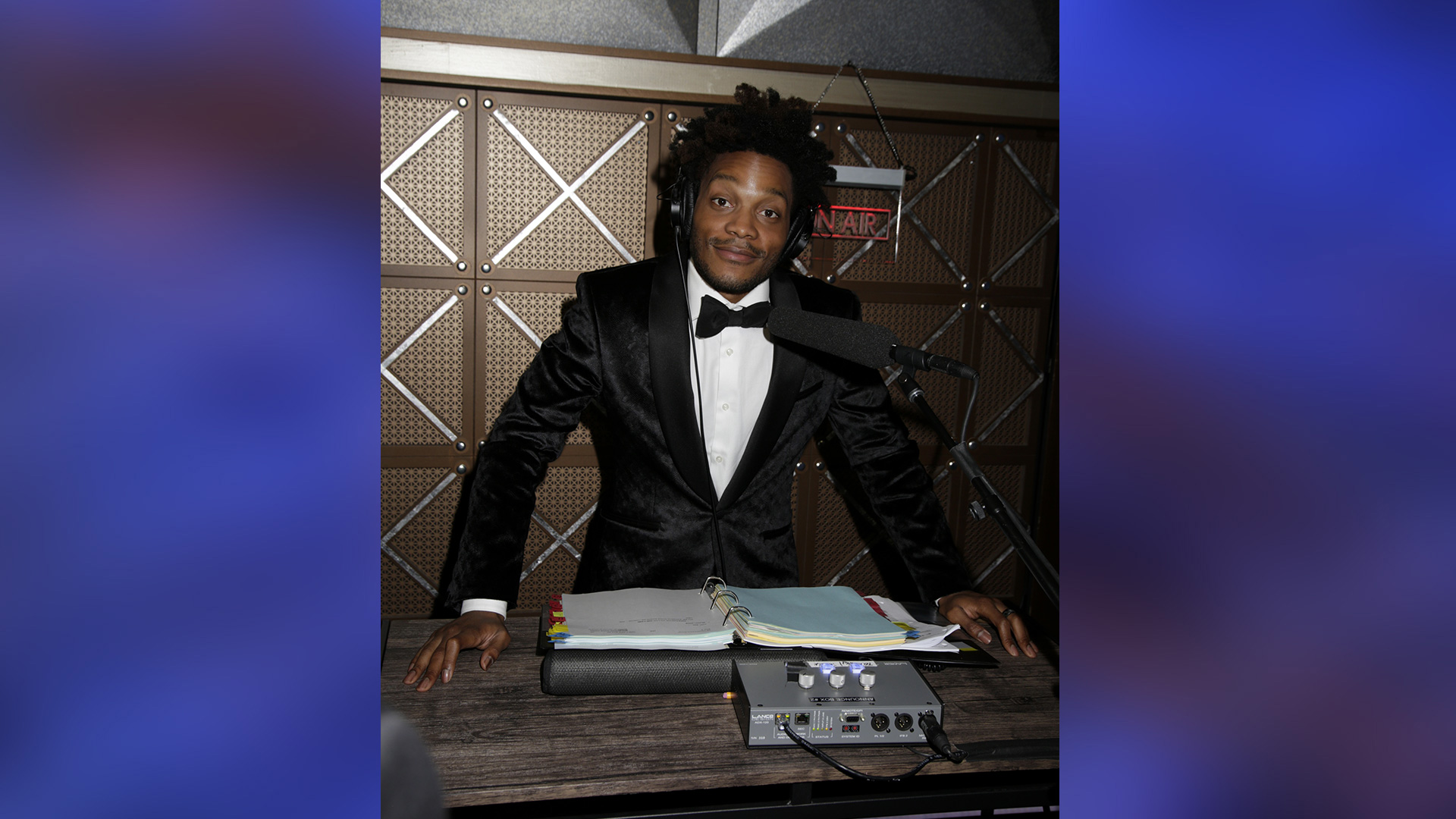 Superior Donuts star Jermaine Fowler shares a cool smirk from his announcer's booth.