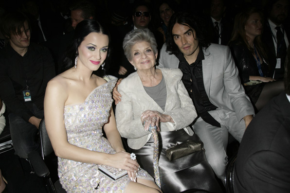 (2011) Katy looks straight out of a fairytale tucked beside her grandmother Ann Hudson and then-husband Russell Brand.