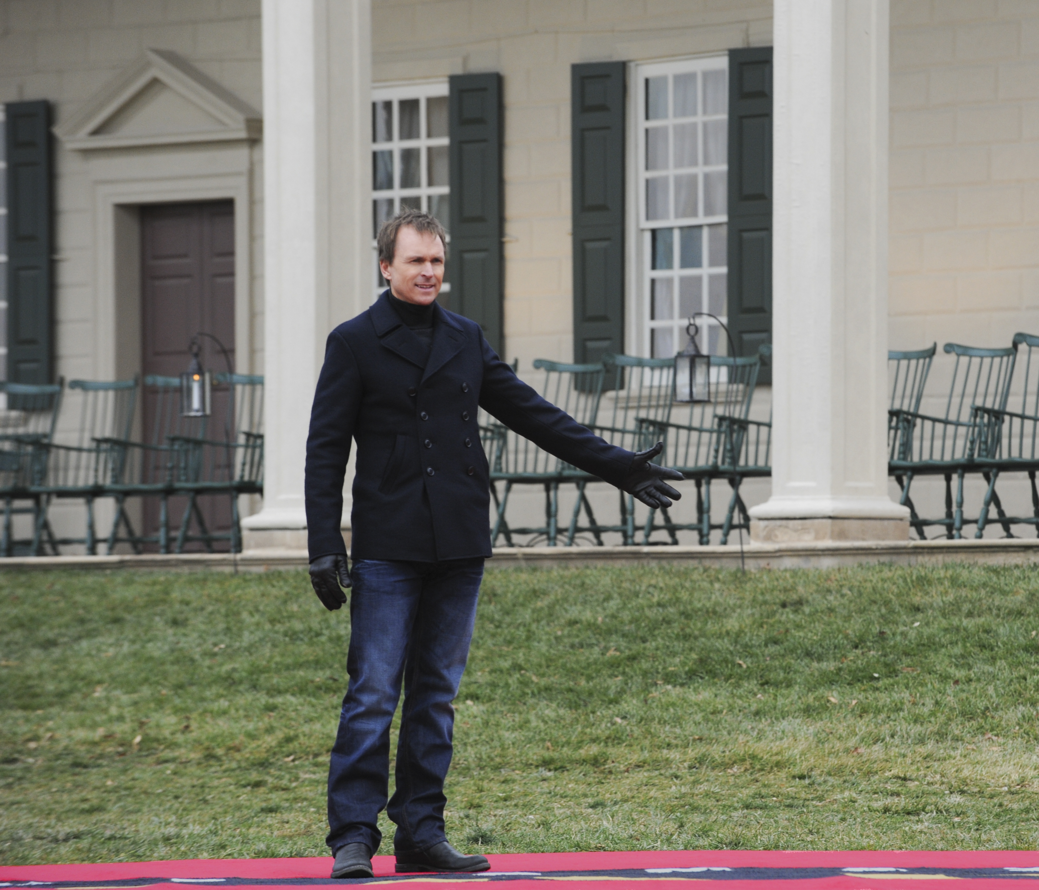 Phil Keoghan waits on the mat in the season finale of The Amazing Race
