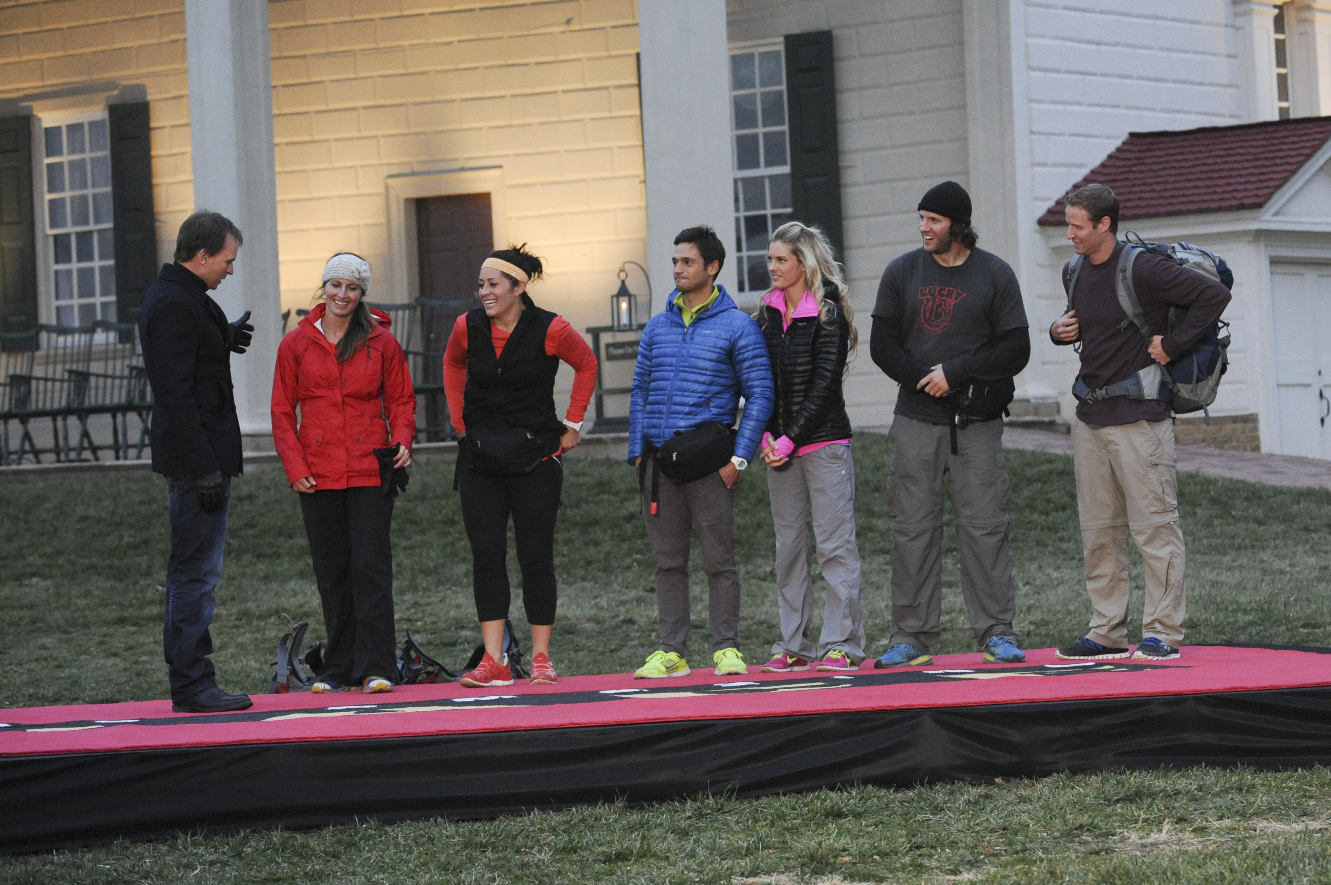 Phil Keoghan greets the final three teams in the season finale of The Amazing Race