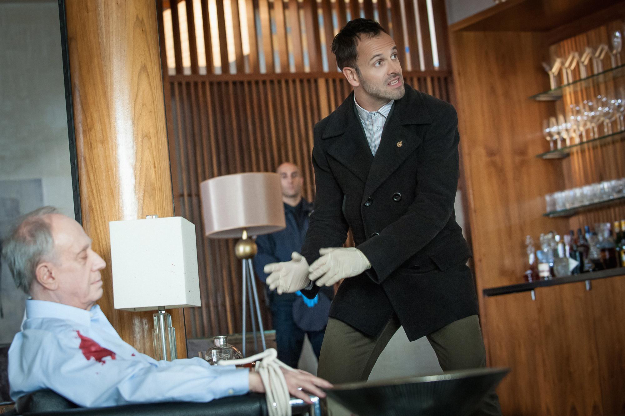 Holmes investigates the murder