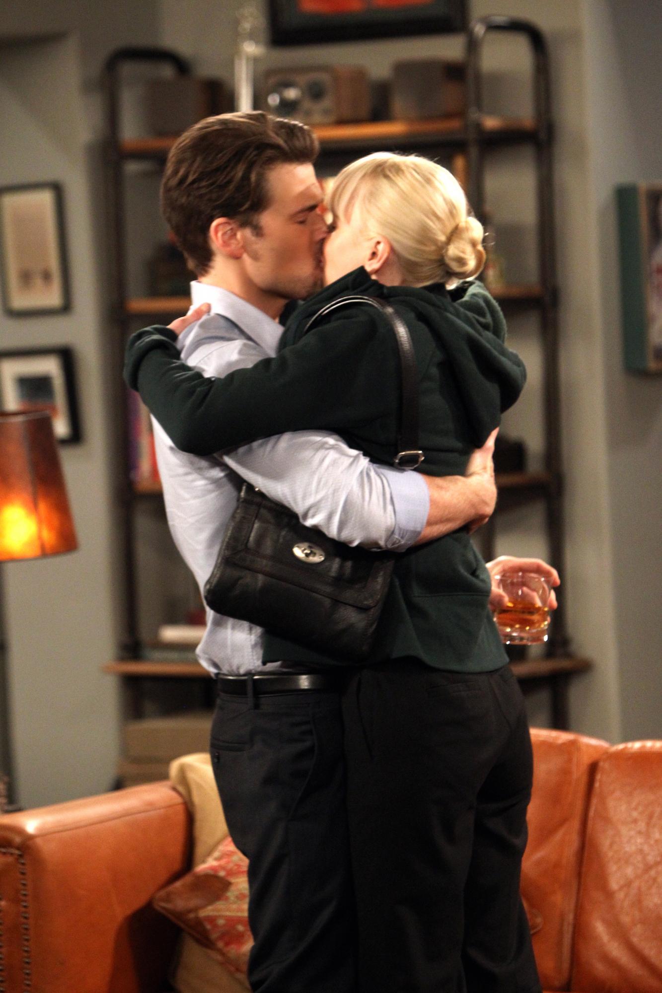 Christy kisses David in