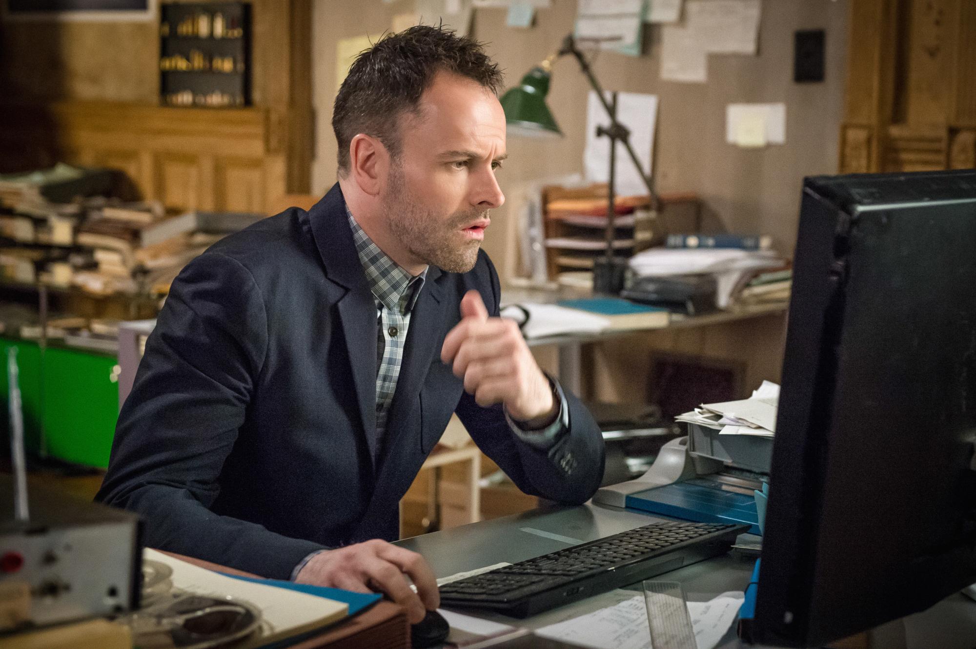 Jonny Lee Miller as Sherlock Holmes in