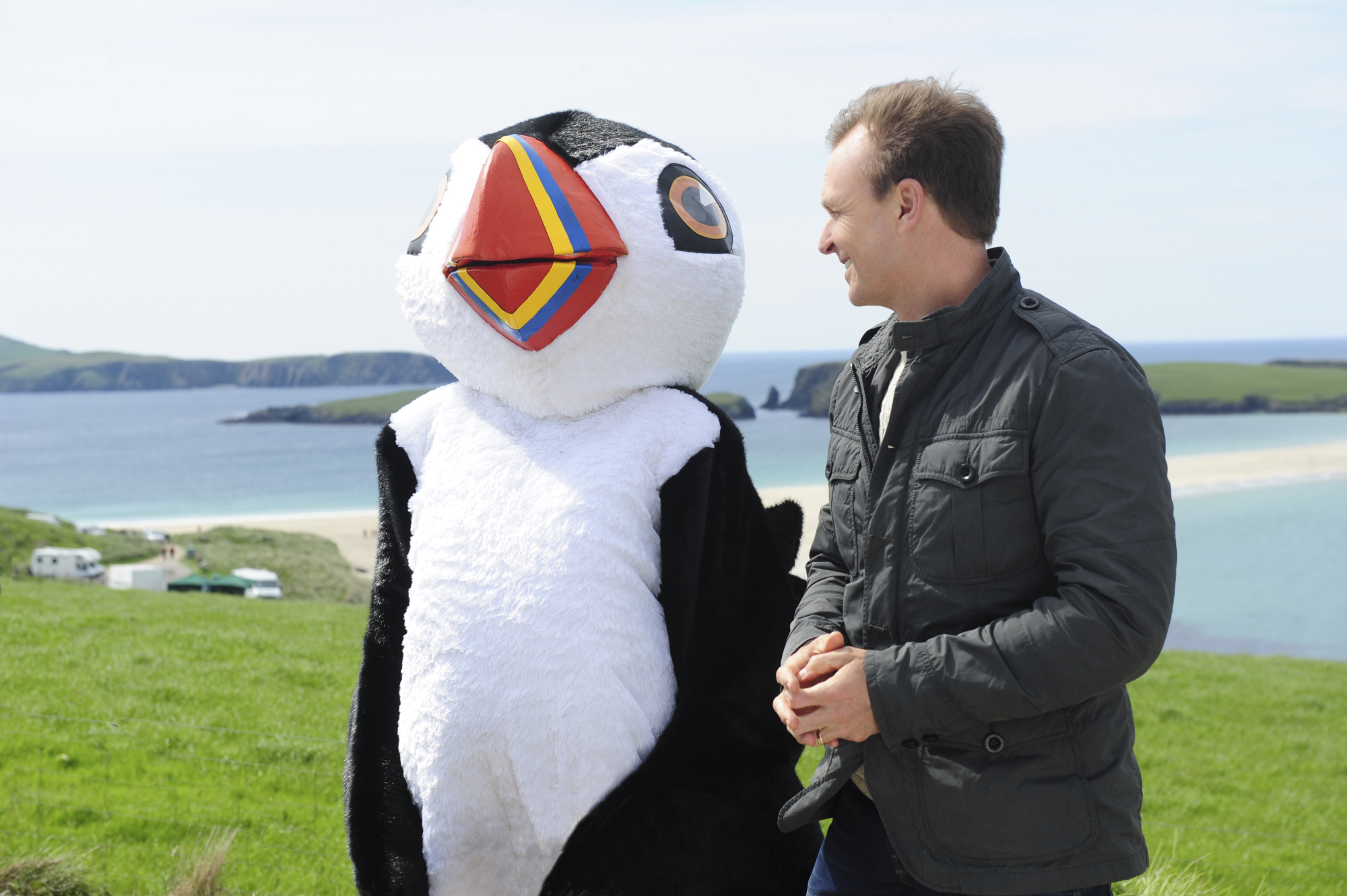 Phil and a Puffin mascot in Scotland