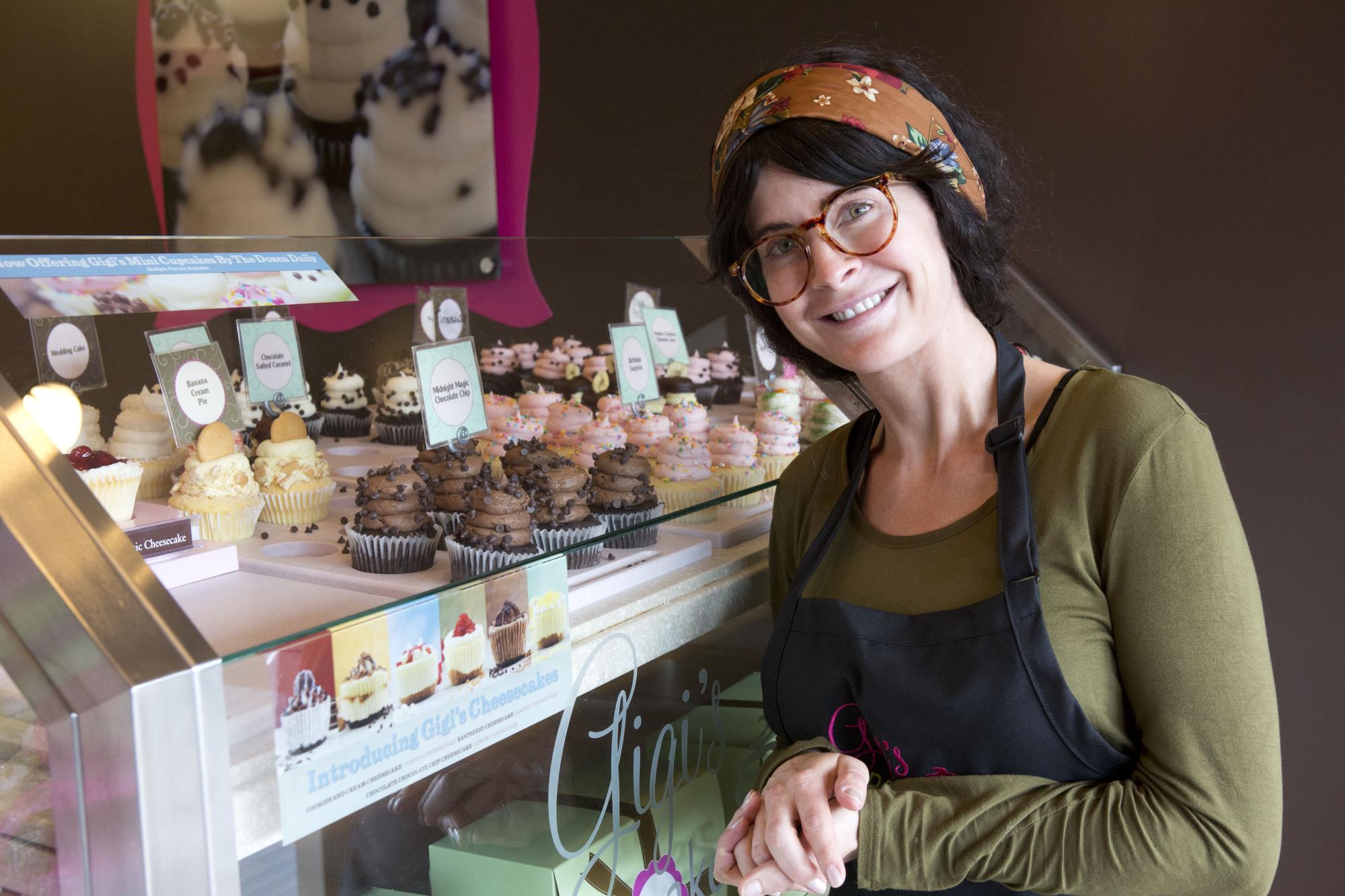 Posing next to her beautiful cupcake creations