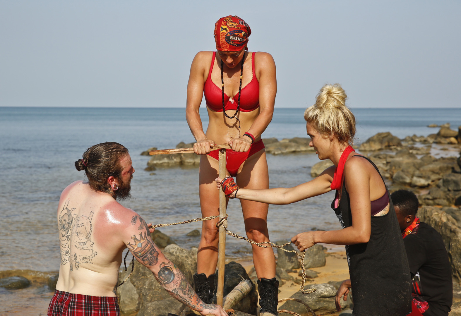 Kyle, Jennifer, and Alecia battle the beating rays during their first day on Survivor.