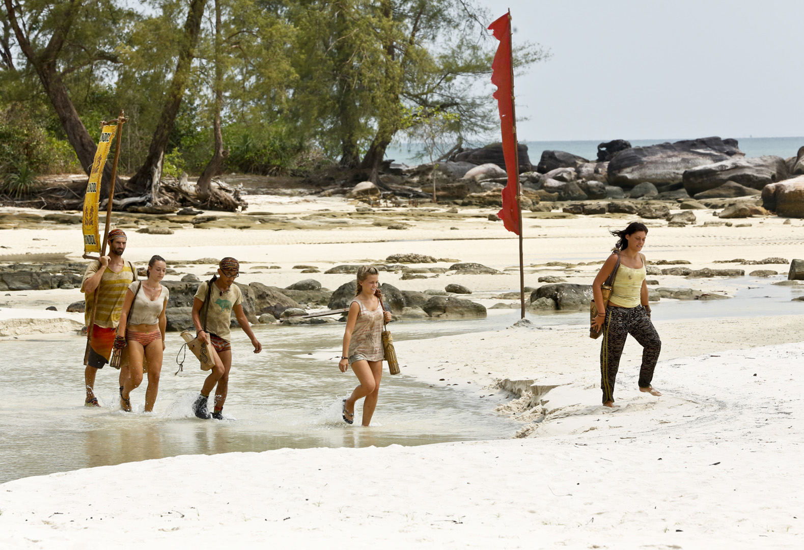 The Beauty Tribe walk the beach to meet up with host Jeff Probst.