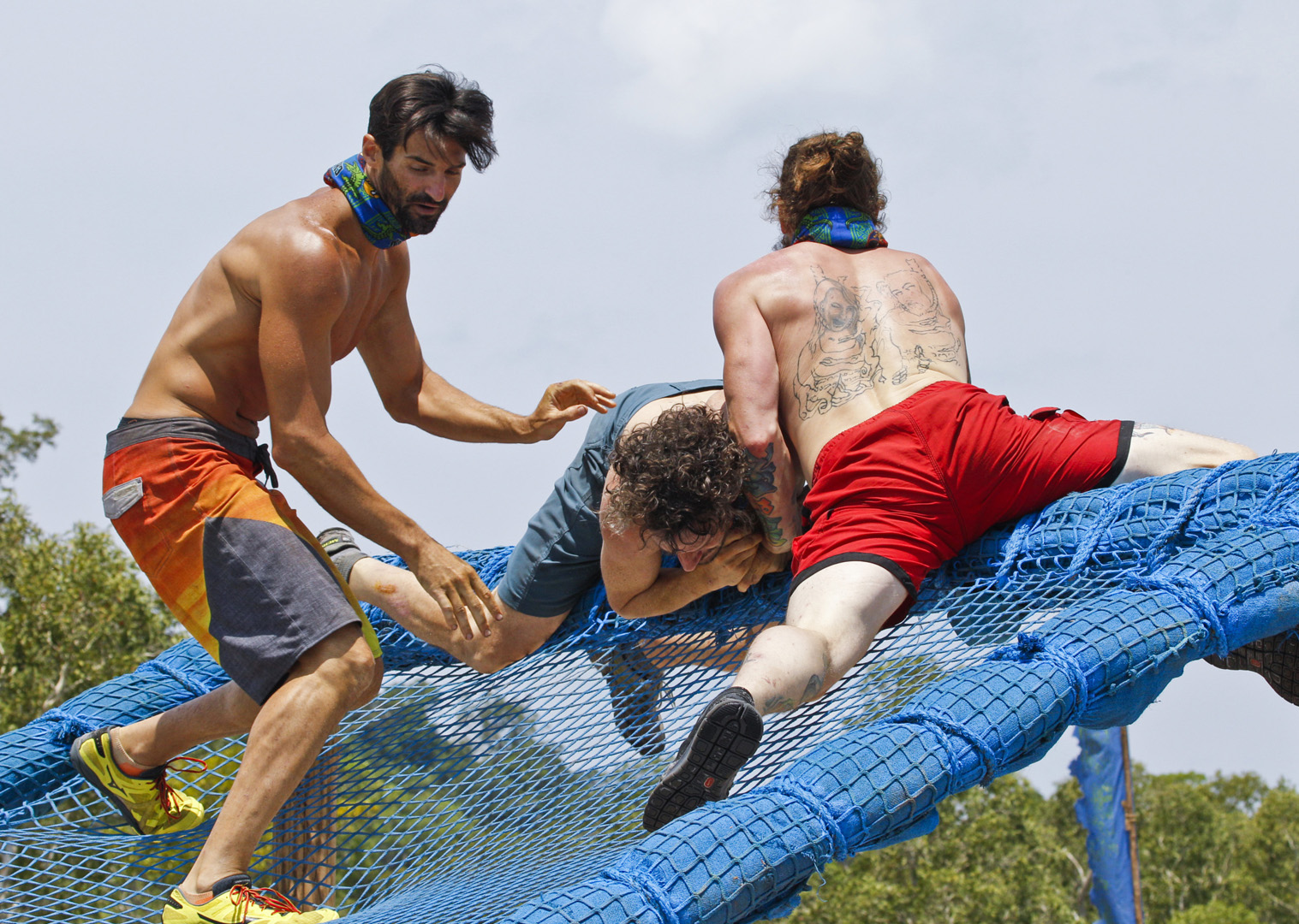 Nick, Neal, and Jason battle the obstacles in the challenge.