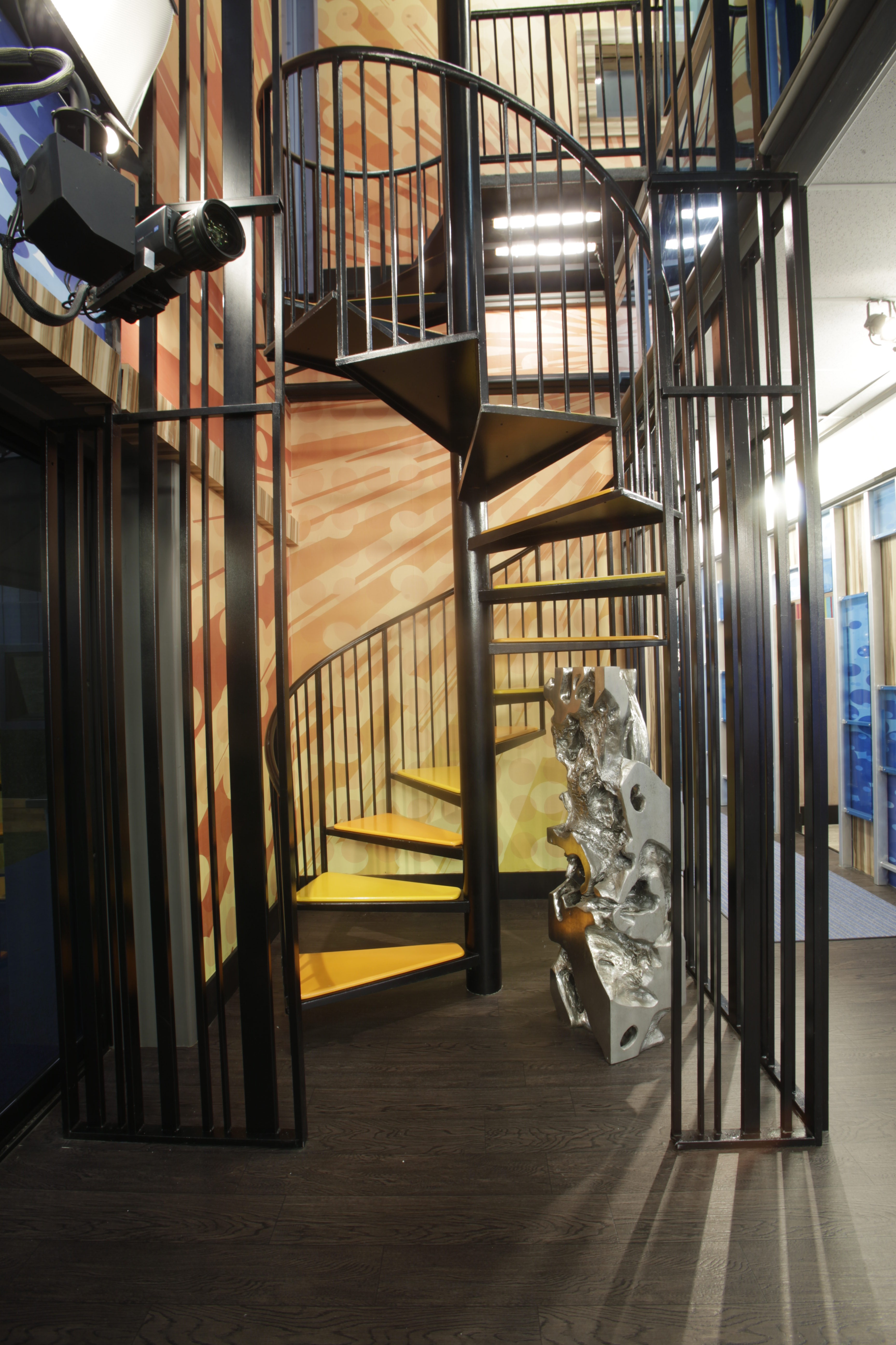 A winding staircase connects the two floors.