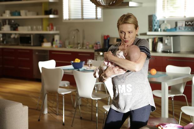 Joan embraces her newborn granddaughter