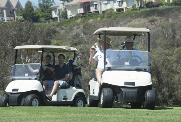 No one's safe when John's behind the wheel of a golf cart