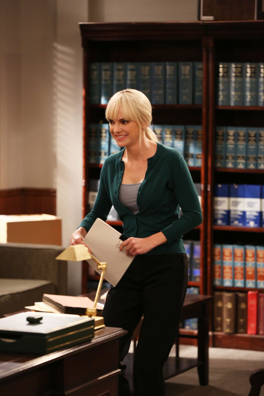Christy files some papers while working in Steve's law office.