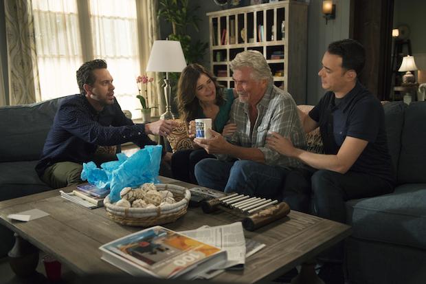 Matt, Heather and Greg give John a gift