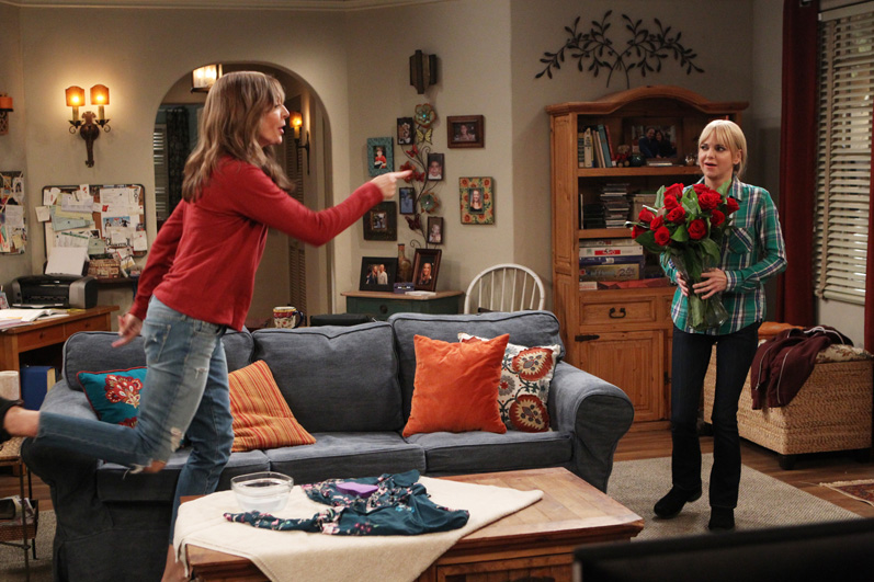 Fred showers Christy with flowers after their first date together.