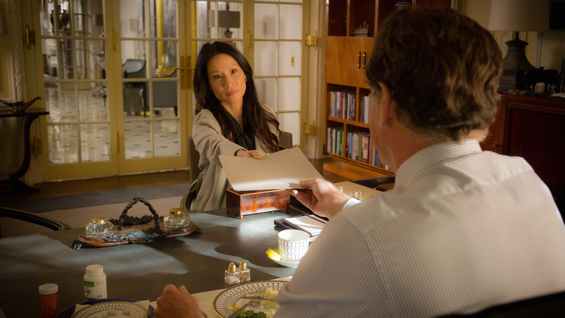 Lucy Liu as Dr. Joan Watson and John Noble as Morland Holmes