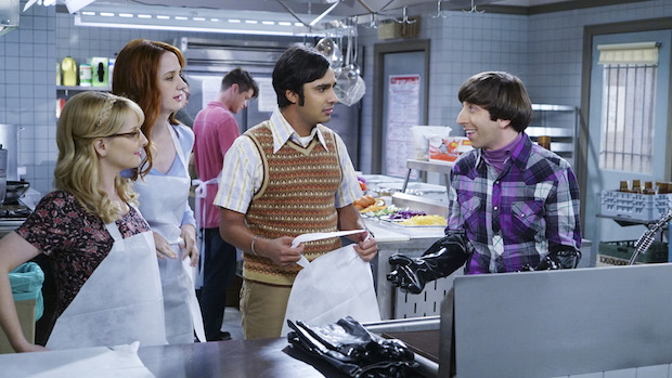 Bernadette, Emily, Raj, and Howard put aprons on to serve food at a soup kitchen