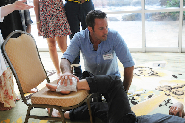 McGarrett ices Danny's foot after he sustains an injury during the therapy retreat. The caring action is an example to all the couples of what a supportive relationship looks like.