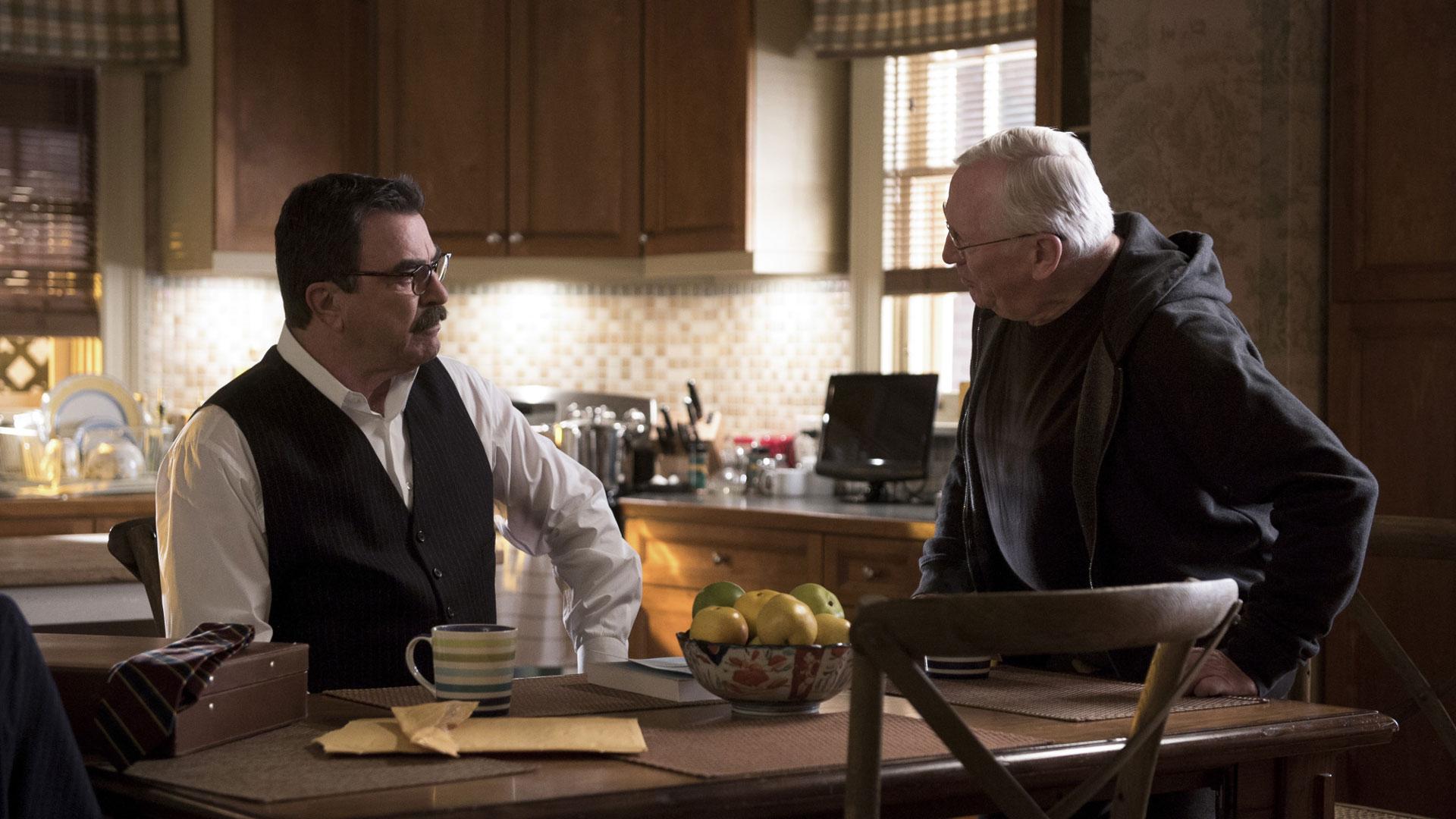 Tom Selleck as Frank Reagan and Len Cariou as Henry Reagan