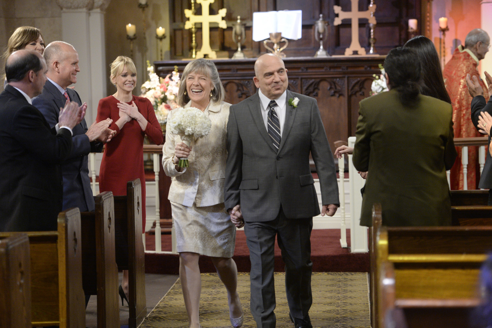 Marjorie happily struts down the aisle with her new husband, Victor.