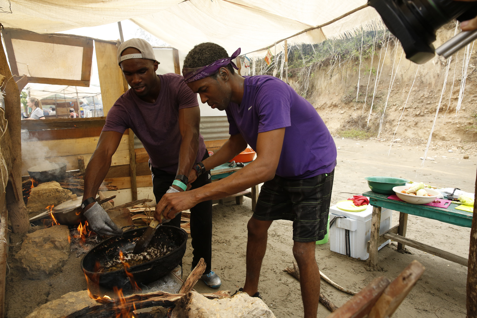 Darius and Cameron cook up some fish, plantains, and rice.