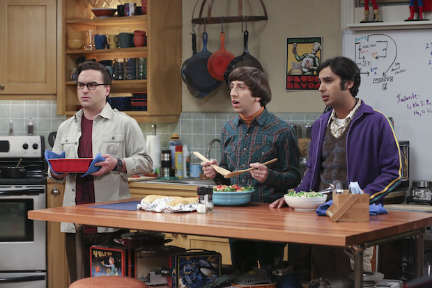 Leonard, Howard, and Raj are shocked while cooking in the kitchen.