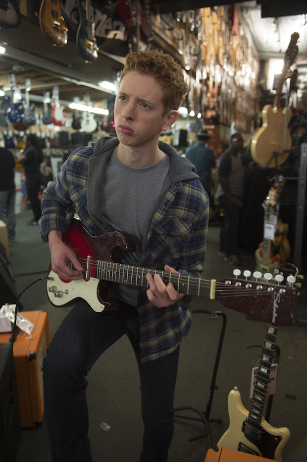 Tyler rocks out at the guitar store.