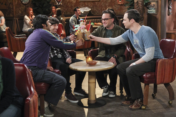 The guys clink glasses to celebrate Howard's new addition.
