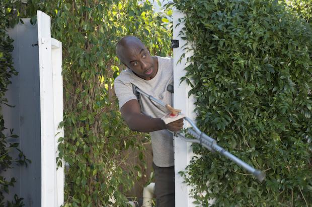 Joan and John's neighbor, Darryl (J.B. Smoove), makes an entrance.