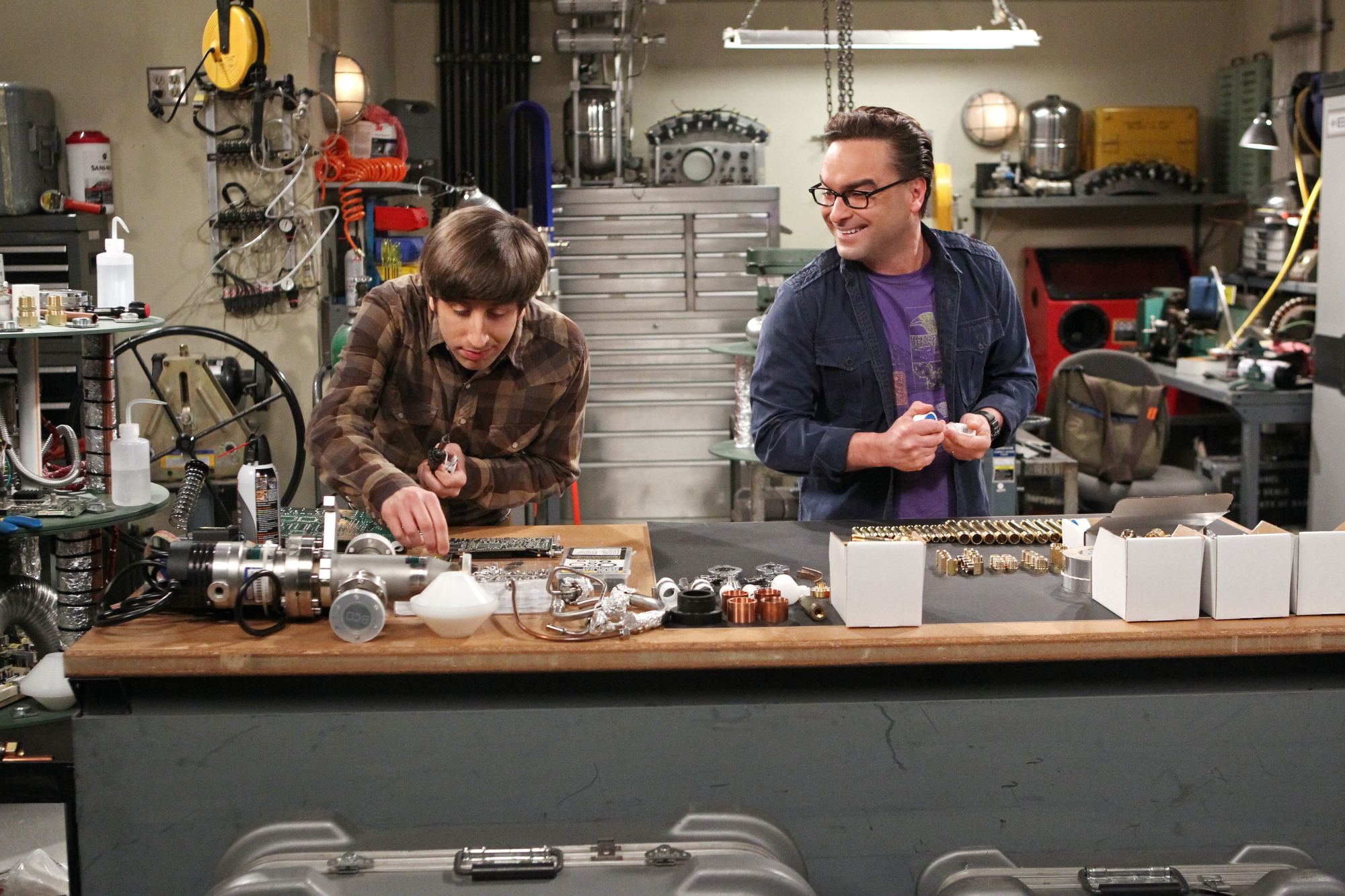 Howard and Leonard work together on a science project.