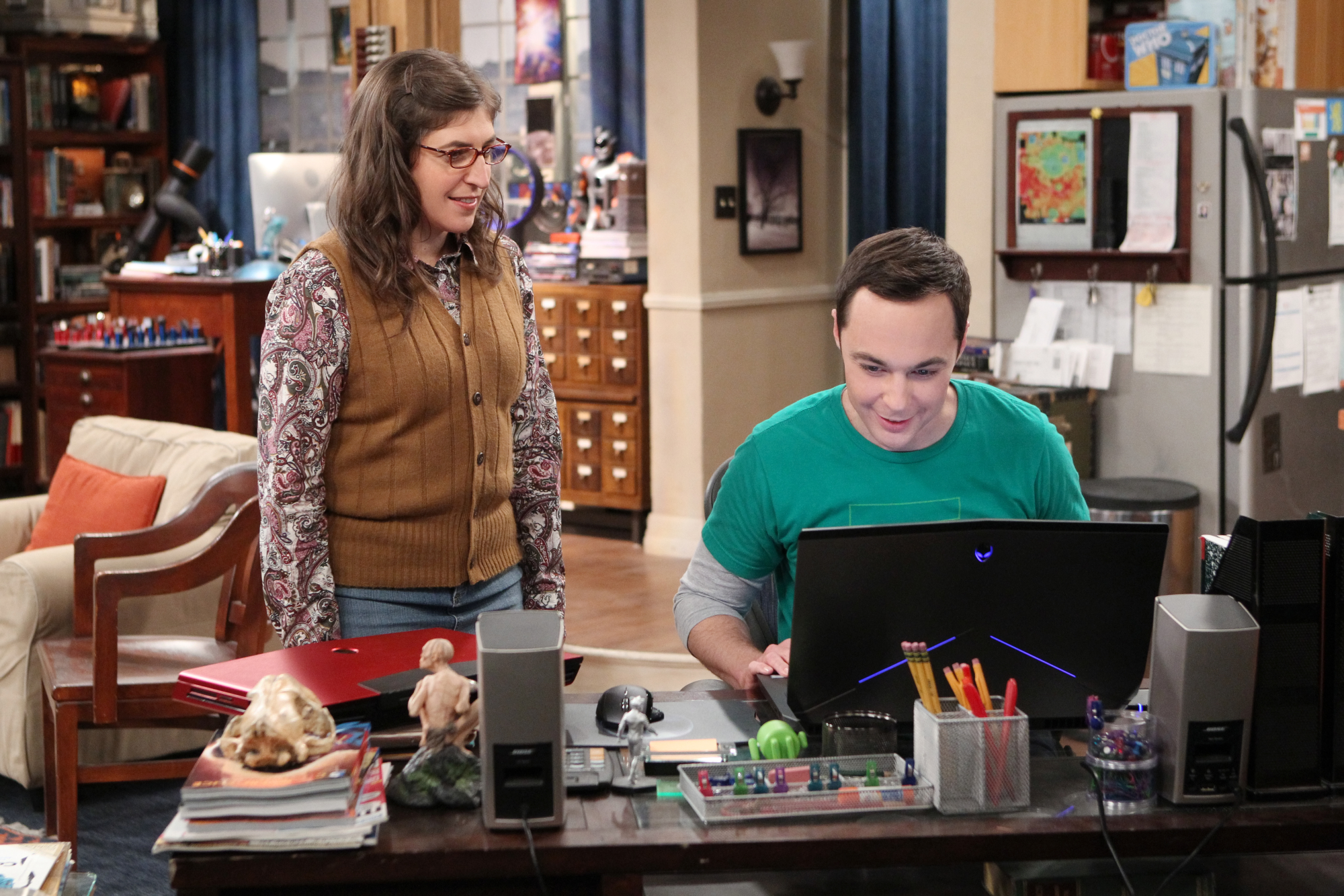 Amy is excited to see that Sheldon likes his new computer.