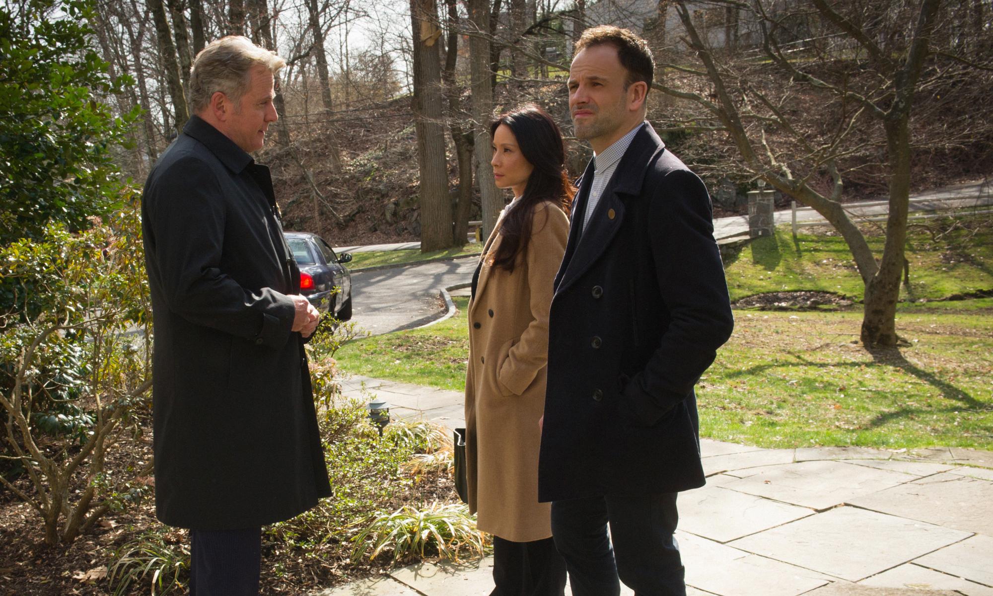 Aidan Quinn as Captain Tommy Gregson, Lucy Liu as Joan Watson, and Jonny Lee Miller as Sherlock Holmes