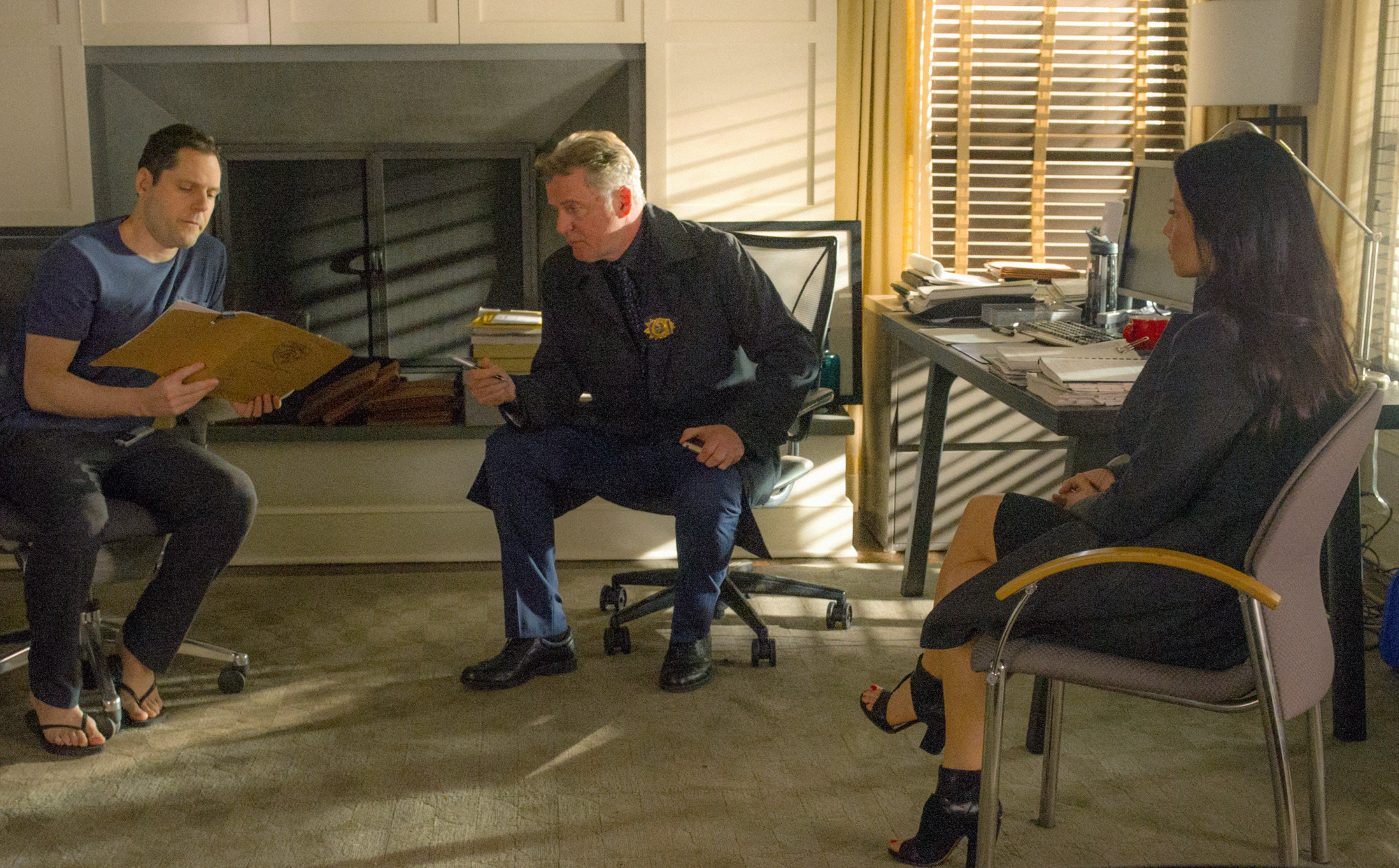 Aidan Quinn as Captain Tommy Gregson and Lucy Liu as Joan Watson