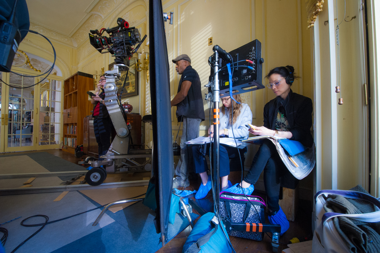 Lucy multitasking on set