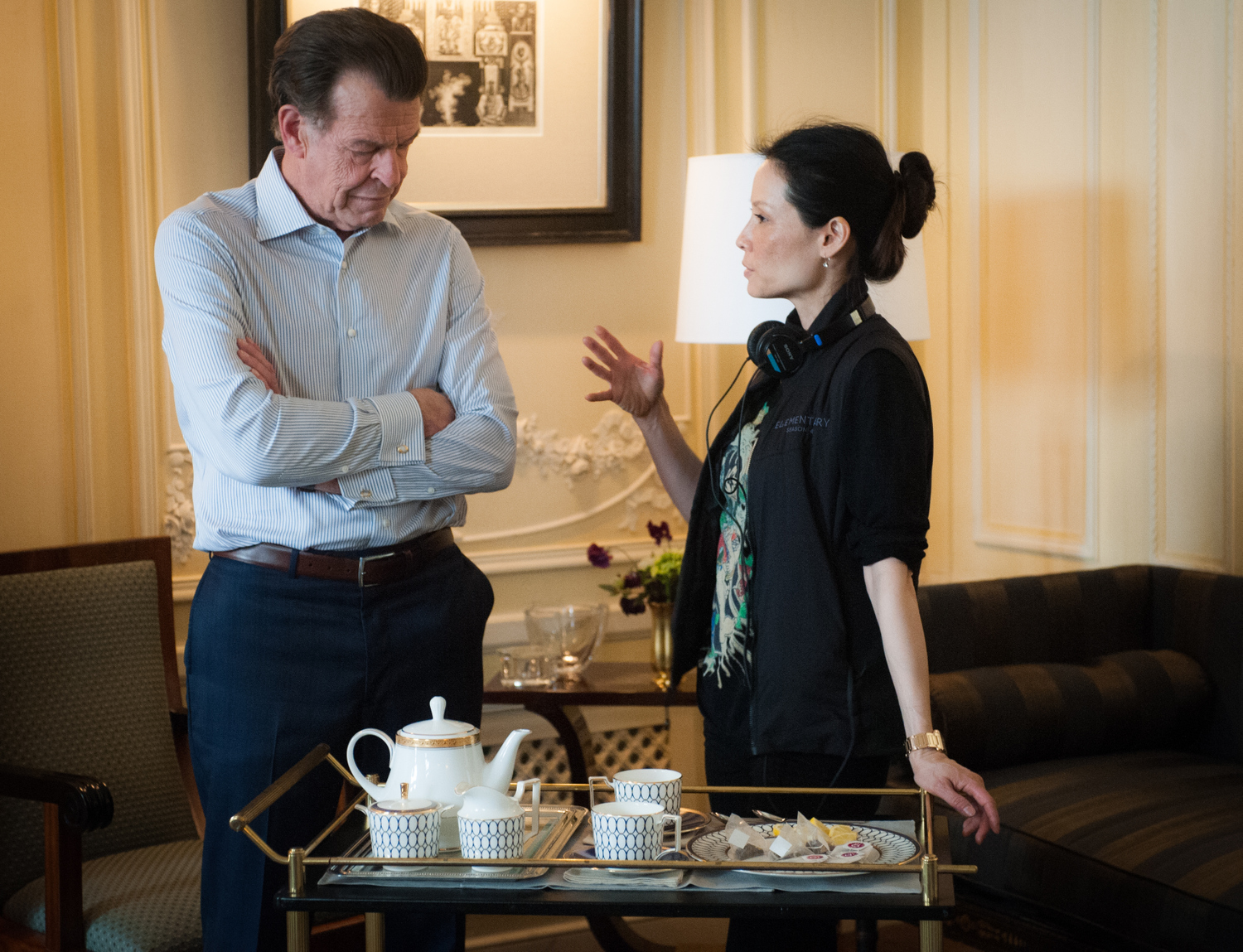 Lucy gives some instructions to John Noble