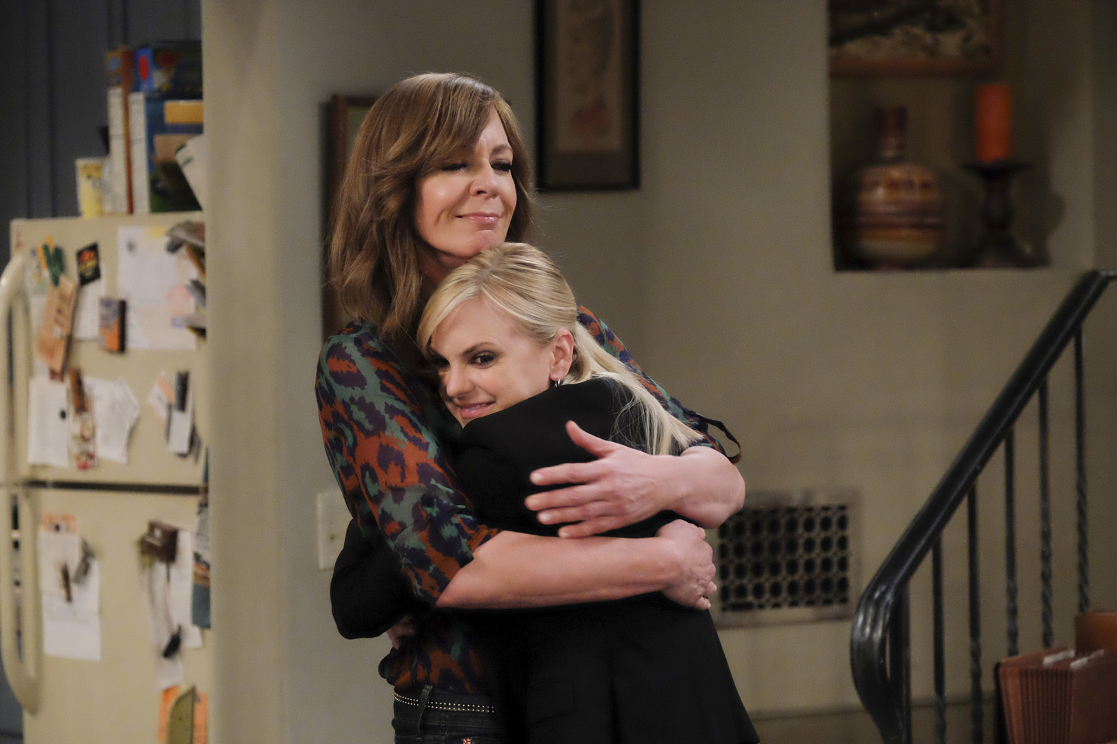 Christy wraps her arms around Bonnie when she returns to the living room.