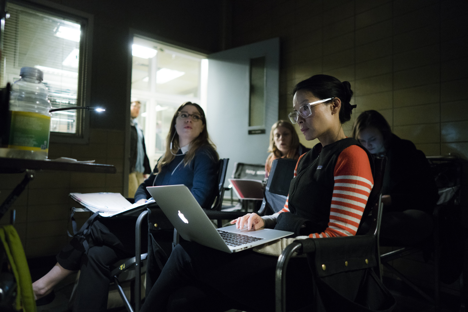 Lucy reviewing parts of the episode with her team