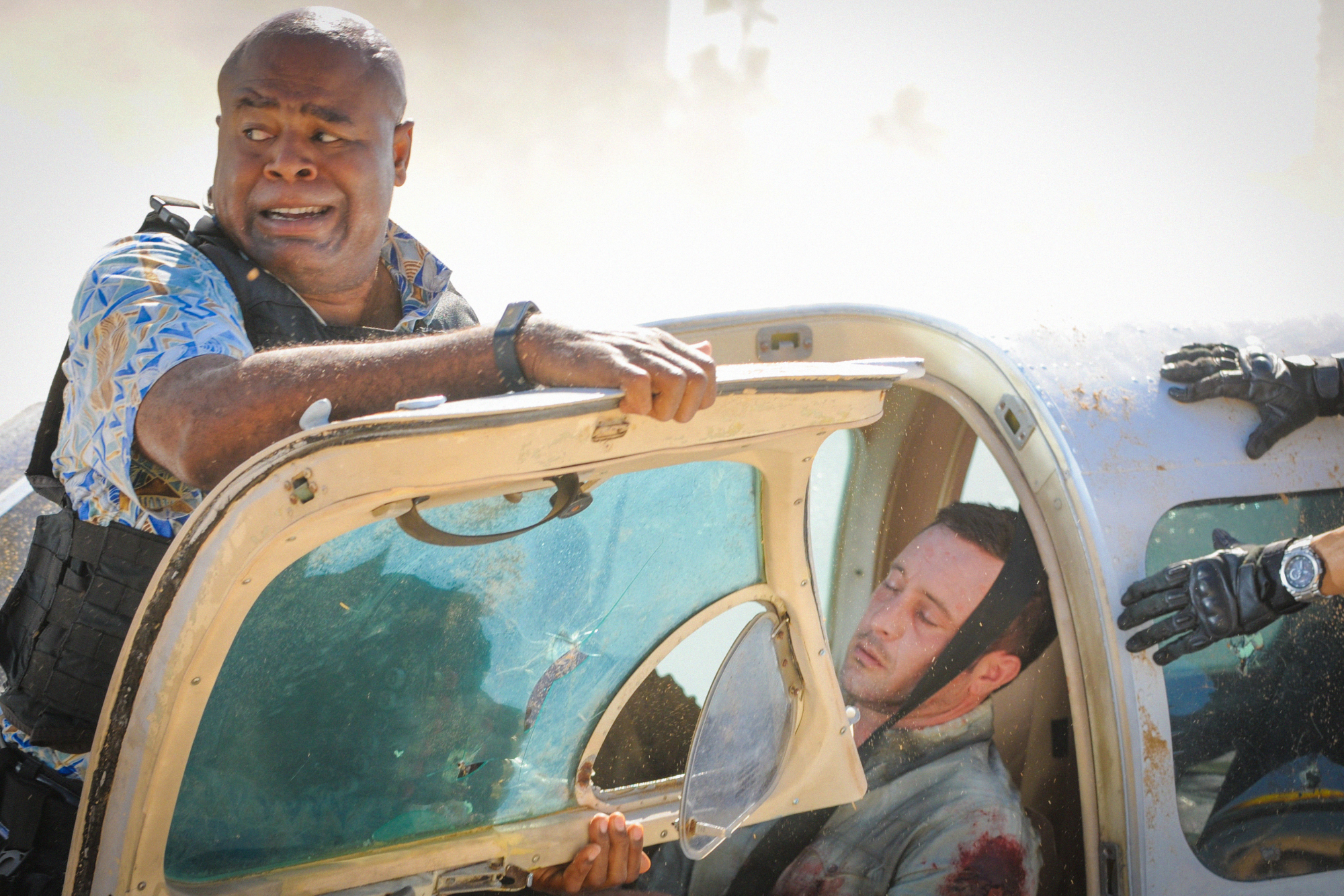 Chi McBride as Lou Grover and Alex O'Loughlin as Steve McGarrett