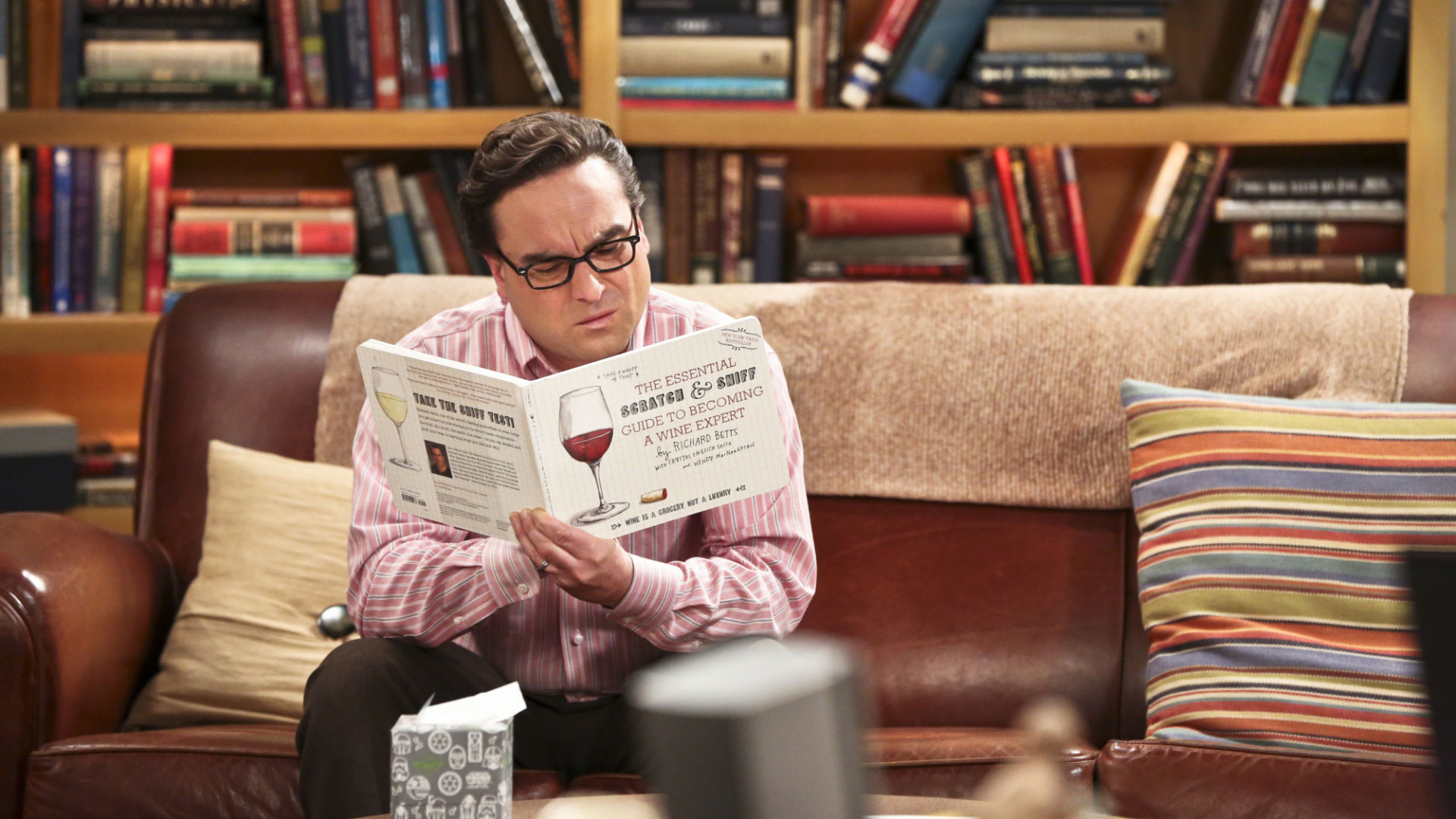 Leonard reads up on wine so he can participate in any potential fermentation conversations.