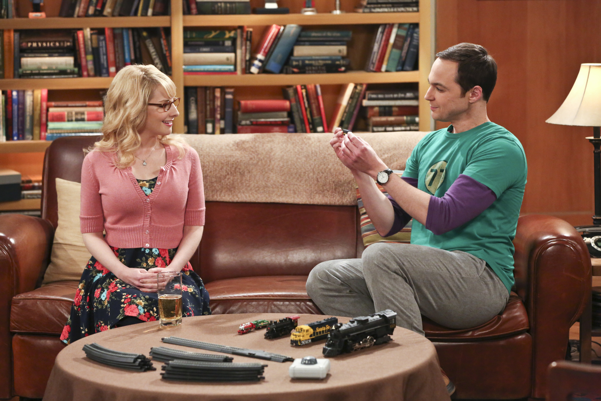 Sheldon shows off his trains to Bernadette.
