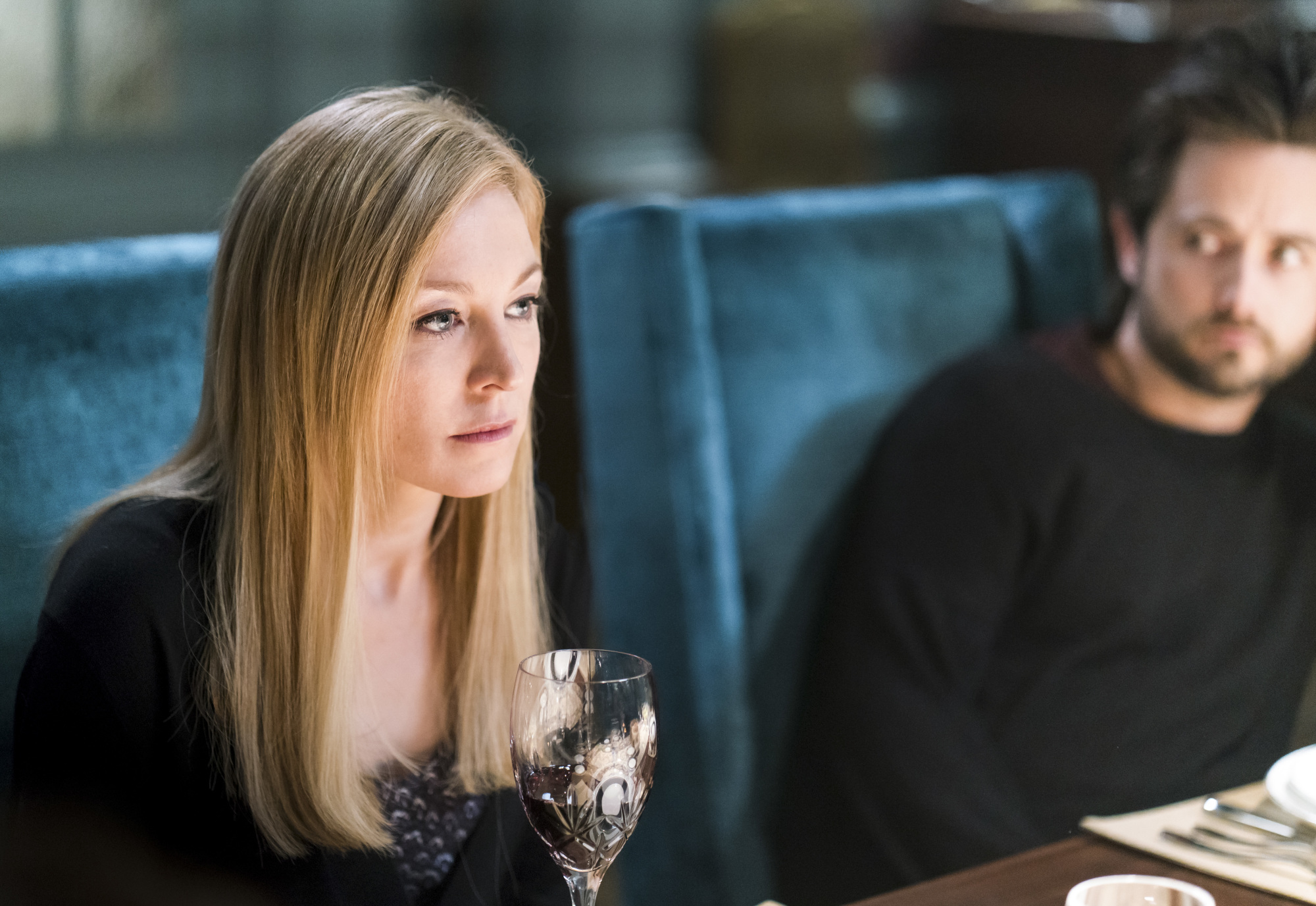 Alison speaks with her family over a tense dinner.