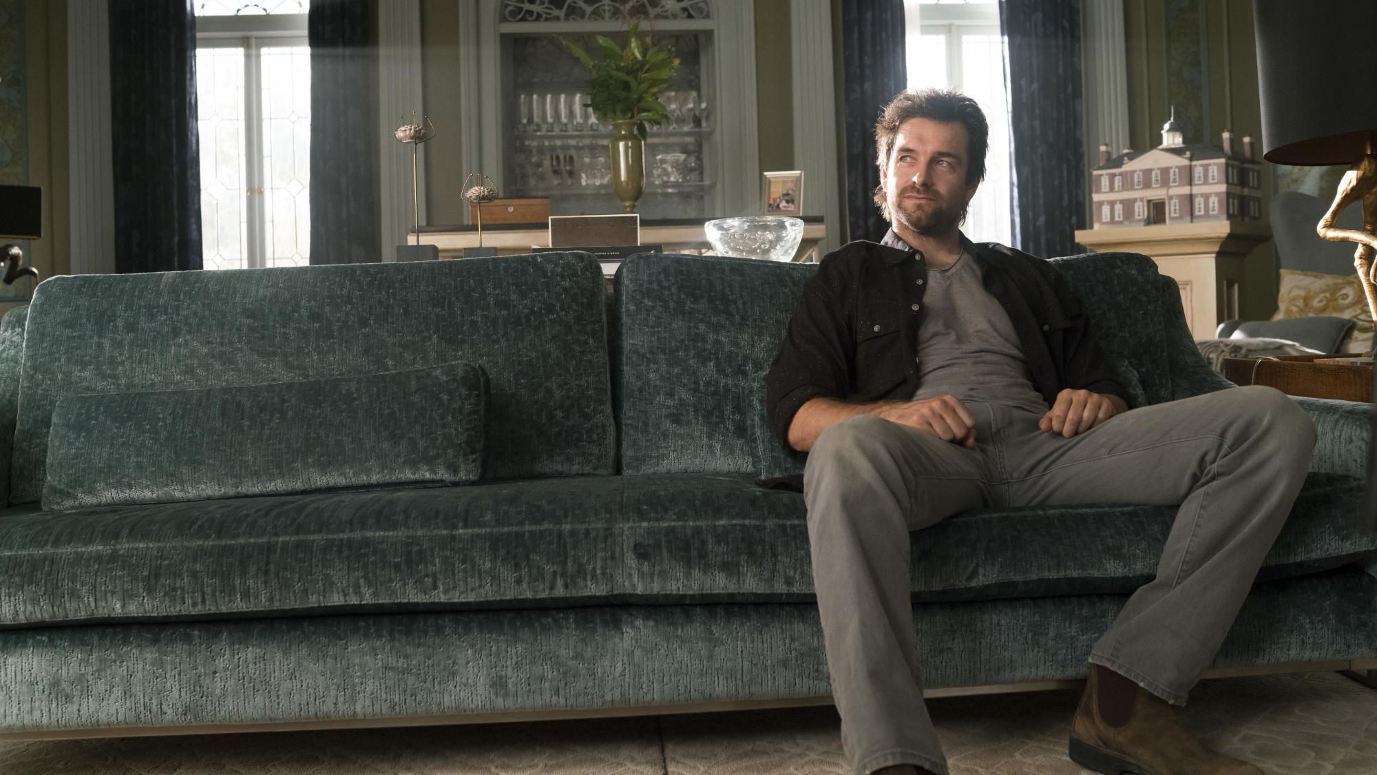 Garrett relaxes in the living room.