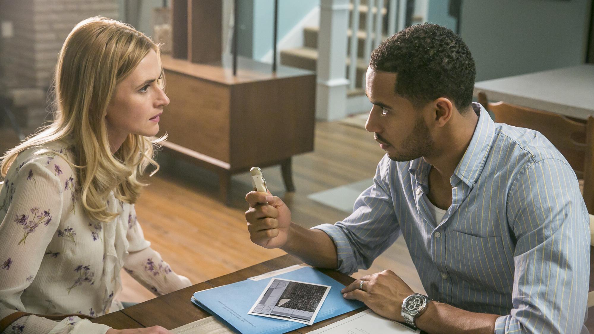 Brady shows Tessa a key piece of evidence.