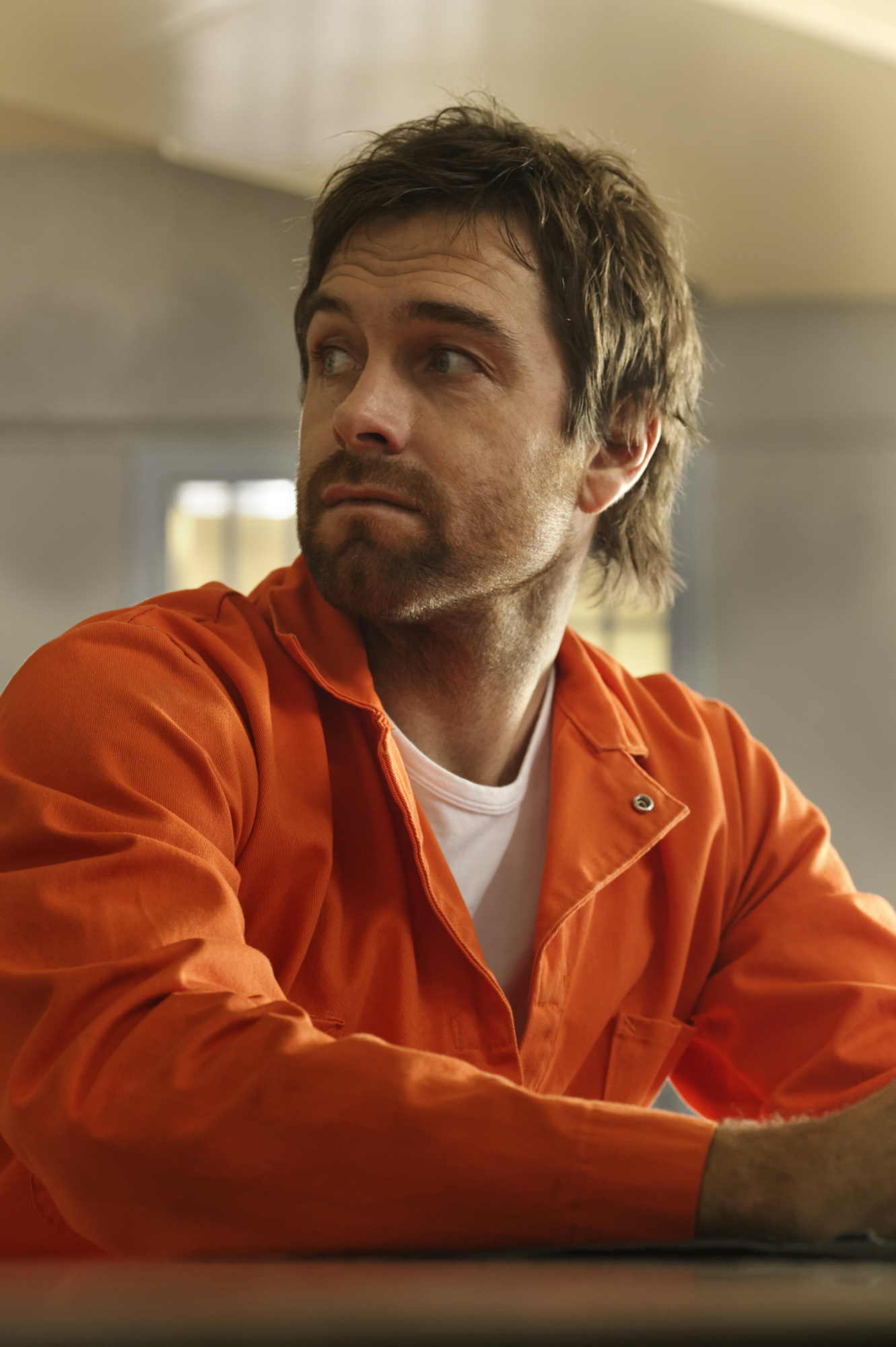 Garrett looks over his shoulder in prison.